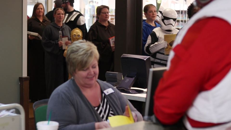 People in Star Wars outfits waiting in line