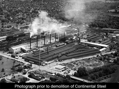 Black and White overhead photo of a large building with the text continental steel prior to demolition