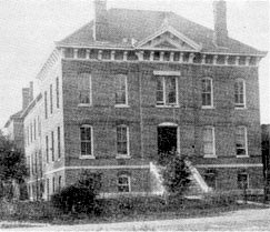 Black and White photo of a large brick house