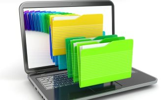 Various colored 3 dimensional folders coming out of a laptop screen